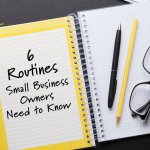 Open notebook with pens and glasses with blog title 6 routines small business owners need to know